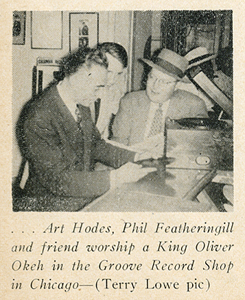 Featheringill et al. inspecting a King Oliver OKeh at the Groove Record Shop