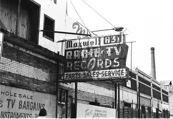 Battered main sign at 831 Maxwell Street, 1975